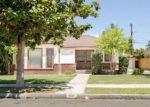 Foreclosed Home en E CORNELL AVE, Fresno, CA - 93704