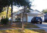 Foreclosed Home en REDLIVE OAKS DR, Orlando, FL - 32818