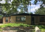 Foreclosed Home en E FLORA ST, Tampa, FL - 33610