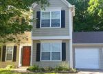 Foreclosed Home en WOODMORE DR SW, Marietta, GA - 30008