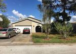 Foreclosed Home en W COURSE DR, Tampa, FL - 33624