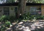 Foreclosed Home en N MANDARINE PL, Tampa, FL - 33617