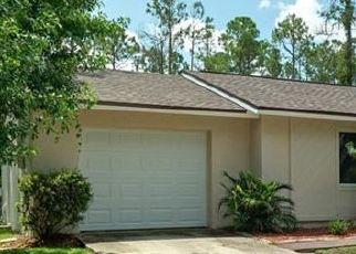 Foreclosed Home en PORCUPINE DR, Palm Coast, FL - 32164