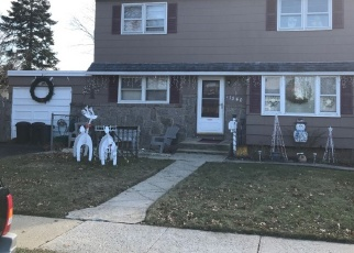 Foreclosed Home en MIDIAN ST, Merrick, NY - 11566