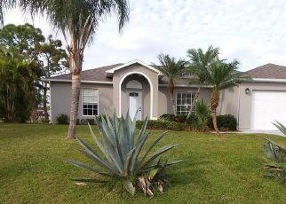 Foreclosed Home en NW EAST DEVILLE CIR, Port Saint Lucie, FL - 34986