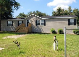 Foreclosed Home en NW CARRIAGE GLN, Lake City, FL - 32055