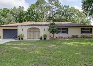 Foreclosed Home en QUAILWOOD DR, Winter Haven, FL - 33880