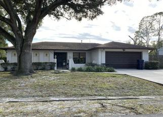 Foreclosed Home in W FARWELL DR, Tampa, FL - 33603