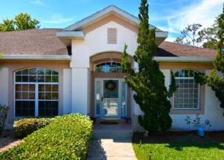Foreclosed Home en FRONTIER DR, Palm Coast, FL - 32137