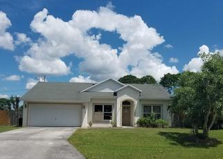 Foreclosed Home in SW DUVAL AVE, Port Saint Lucie, FL - 34983