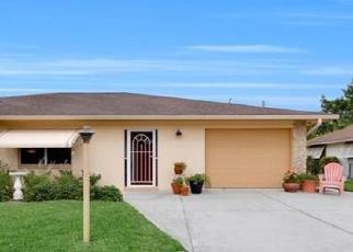 Foreclosed Home en SE 25TH LN, Cape Coral, FL - 33904
