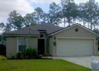 Foreclosed Home en WELLWOOD LN, Palm Coast, FL - 32164