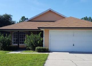 Foreclosed Home en DEAN POINT PL, Orlando, FL - 32825